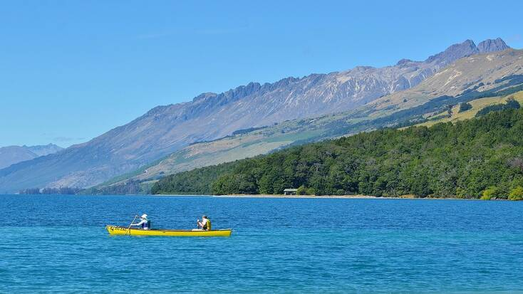 Canoeing on Lake Wakatipu, New Zealand. Vacations for outdoor enthusiasts