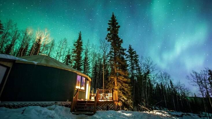 The Northern Lights over a yurt near Fairbanks