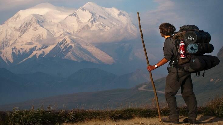 A traveler hiking in Alaska