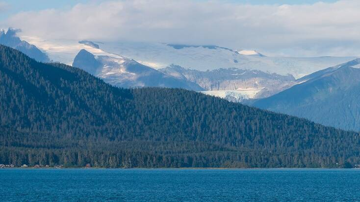 A view of a lake, mountains, and a forest near Juneau, Alaska