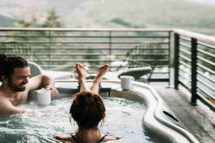A couple enjoying hot tub getaways