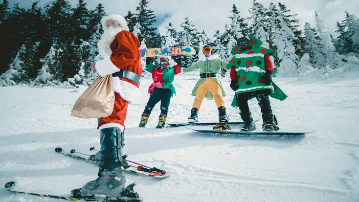 Skiers in Christmas costumes