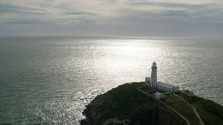 A view over an Anglesey lighthouse and the ocean