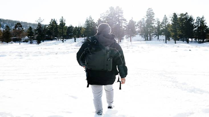 A man on a mountain hiking trail