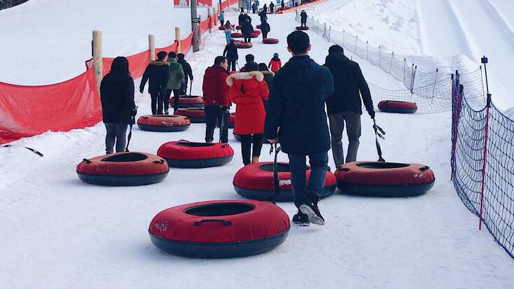 People going snow tubing for their winter outdoor activities
