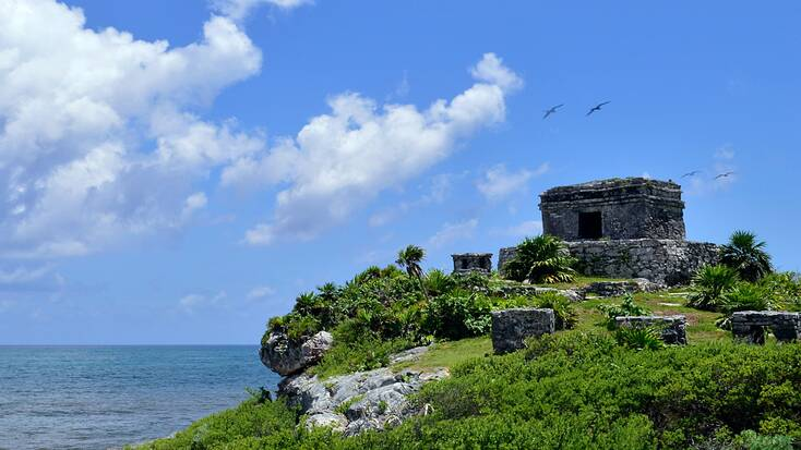 Mayan ruins overlooking the coast in Tulum, Mexico