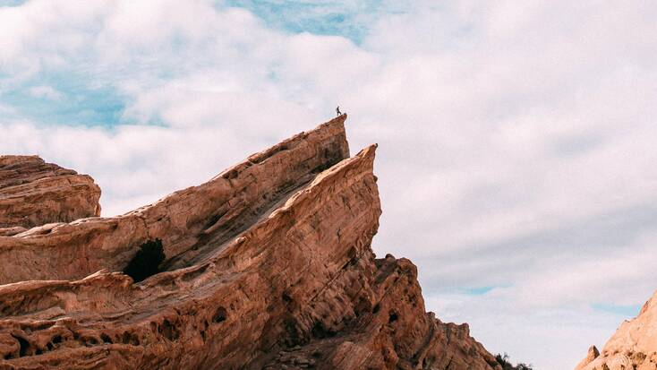 Someone standing at the top of Vasquez Rocks Natural Area Park
