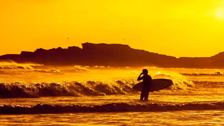 Someone surfing at sunset in Baja California