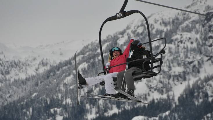 Two people on a ski lift in Whistler, BC