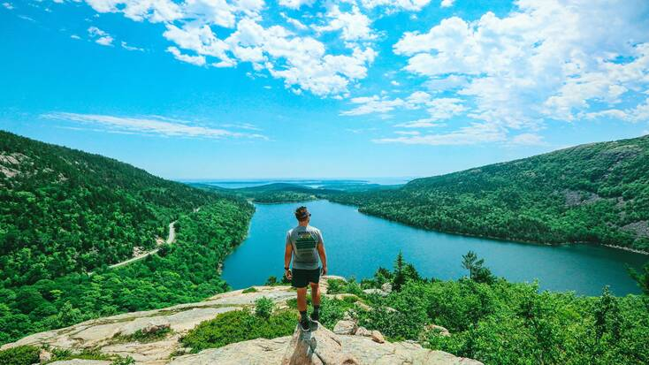 A hiker admiring the views in Acadia National Park