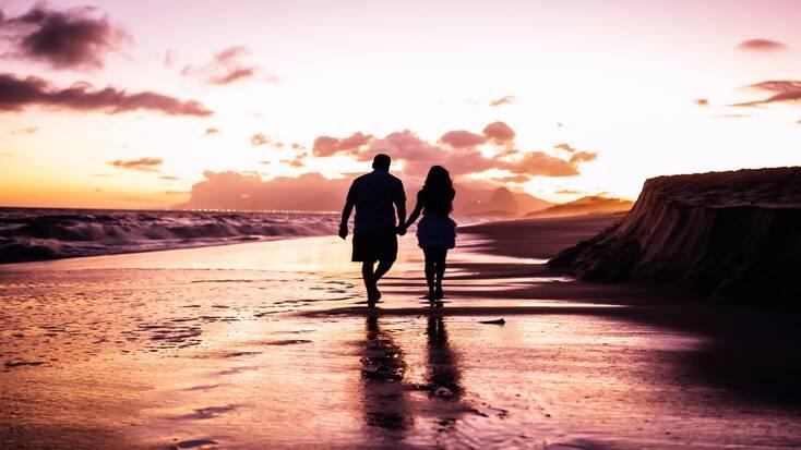 A couple enjoying romantic getaways at the beach