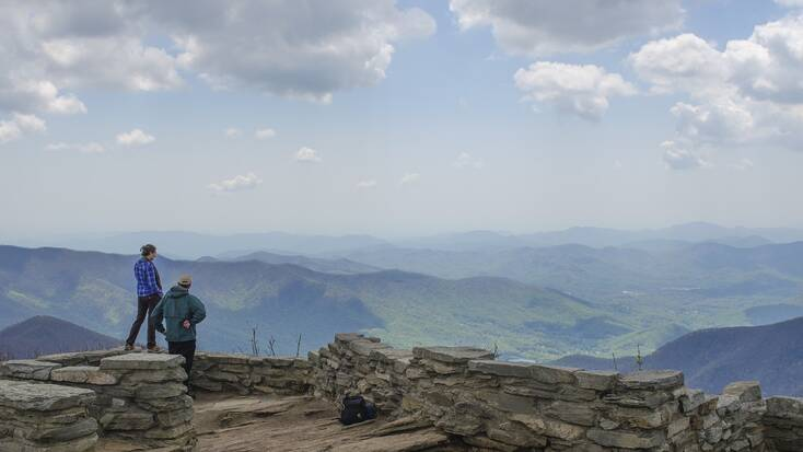 Hikers enjoying a view over the Appalachians on their mountain vacation