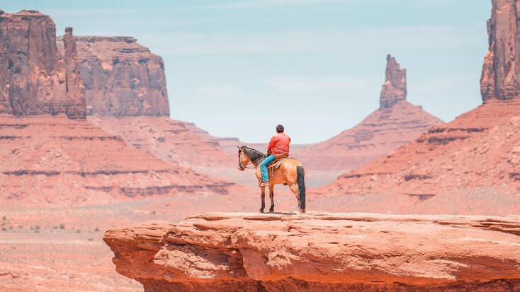 A man on a horse in Monument Valley, one of the best things to do in Arizona