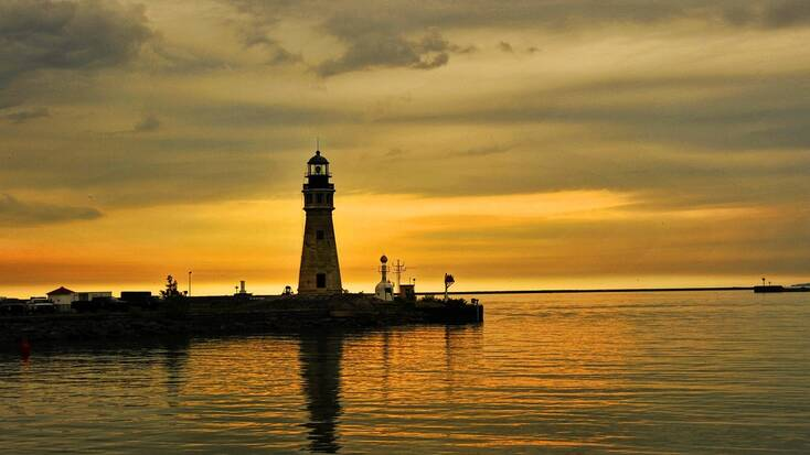 Sunset over a lighthouse on Lake Erie