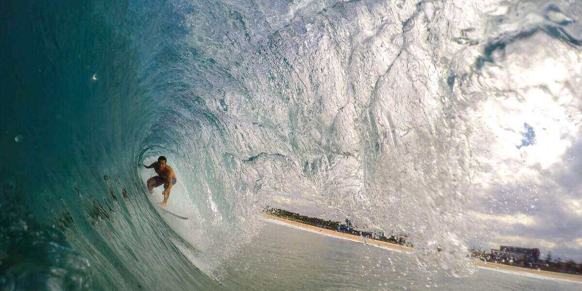 Someone surfing a tube in the West Coast, USA