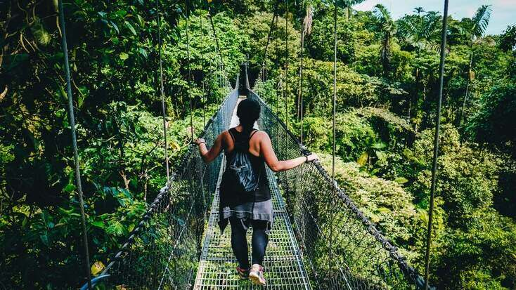 A tourist discovering some of the tropical places to visit in Costa Rica
