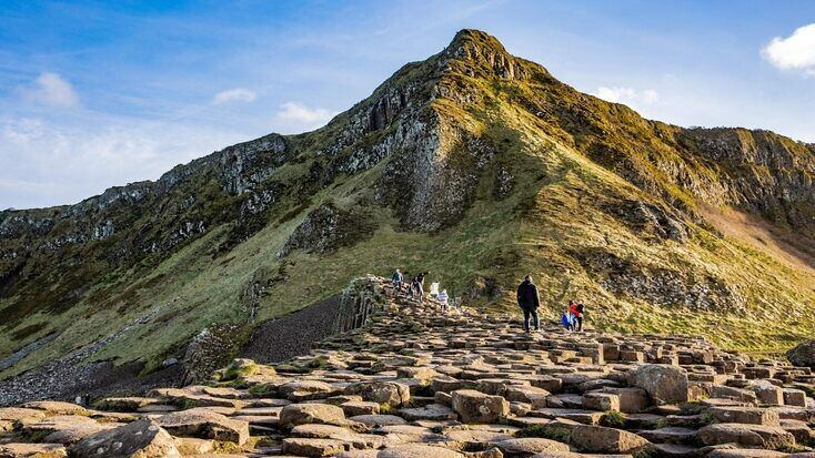People exploring the rock formations of Giant's Causeway