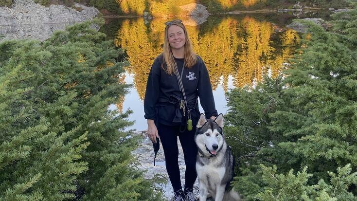 Katherine and her pup Slim while glamping in Masschusetts