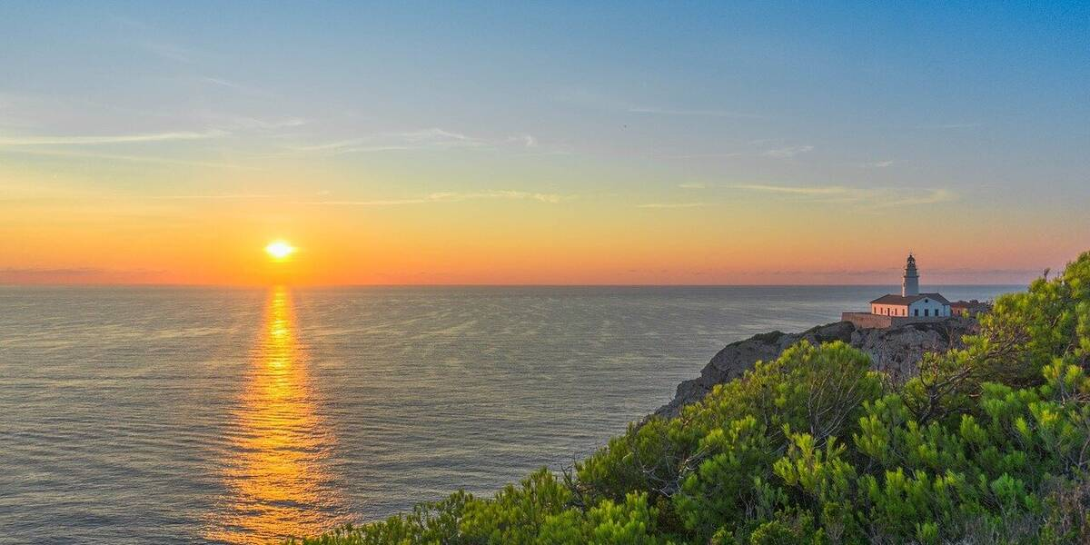 Sunset over the coast of Mallorca one of the best places to visit for holidays in Spain