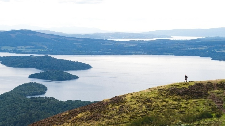 A hiker enjoying the views of Loch Lomond during the spring bank holiday