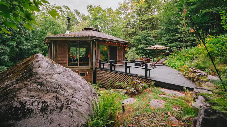 Enjoy Massachusetts glamping at this treehouse cabin!
