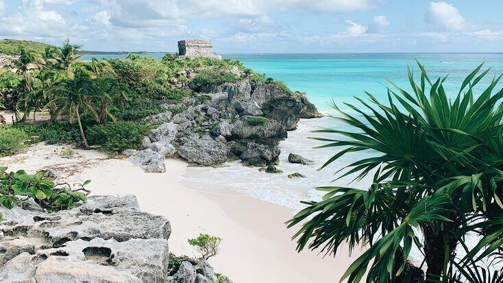 A view over a beach in Quintana Roo and ruins in Mexico