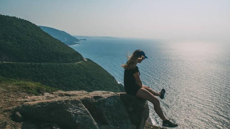 A hiker enjoying views from Cape Breton, Nova Scotia