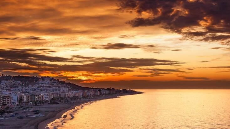 Sunset over El Rincon de la Victoria, one of our favorite Malaga beaches