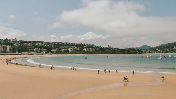 The beach in San Sebastian with holiday makers relaxing