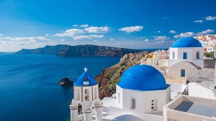 A view of the ocean from Santorini, Greece, one of our favorite family vacation spots