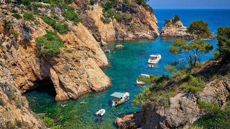 People enjoying blue waters near Spanish beaches in the perfect family vacation spots