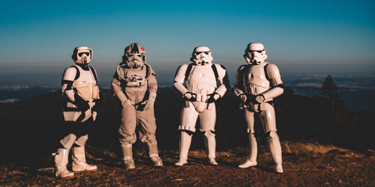 Four friends dressed in stormtrooper uniforms to celebrate Star Wars Day