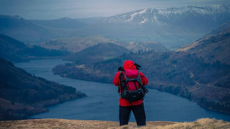 A hiker looking over the views of Steel Fell, Keswick, Cumbria
