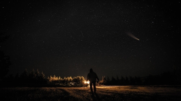 A man viewing the stars during a meteor shower