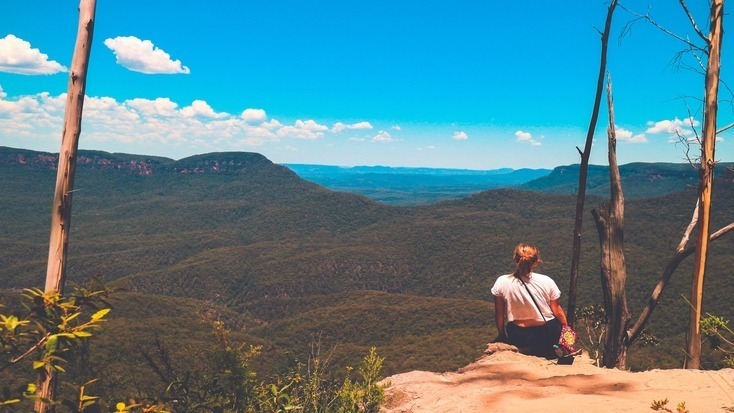 A tourist enjoying views over the Blue Mountains, NSW, for their Queen's Birthday Weekend getaways