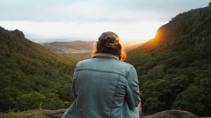 A visitor enjoying a stunning sunset over the Lamington National Park, Queensland during Queen's Birthday Weekend