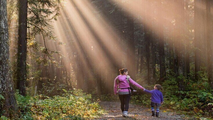A mother and daughter walking in the woods, for things to do for Mothers Day