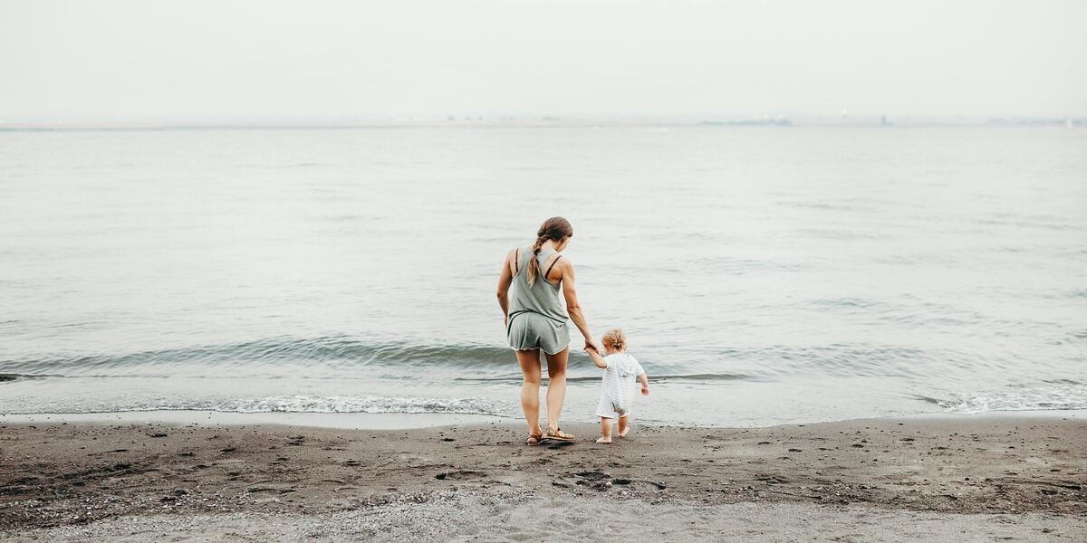 A mother and daughter paddling in the sea, one of our favorite things to do for mothers day