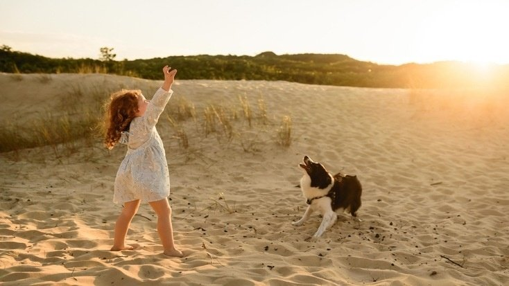 A girl and her dog at one of the beaches that allow dogs