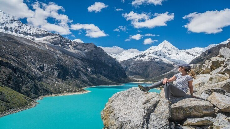 A woman looking at Lake Paron - one of the best lakes in South America