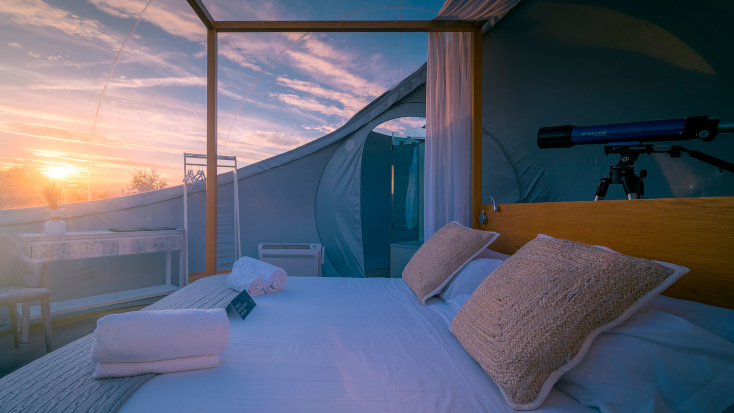 Glamping Hub's Host of the Month for August 2021: Alejandro in Spain. Luxury camping bubble dome in Spain.