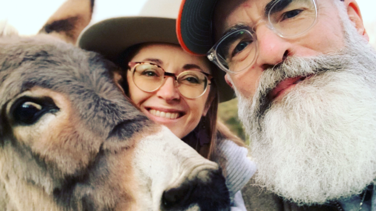 Host of the Month September 2021 - Sherry and Houston smiling with their donkey.