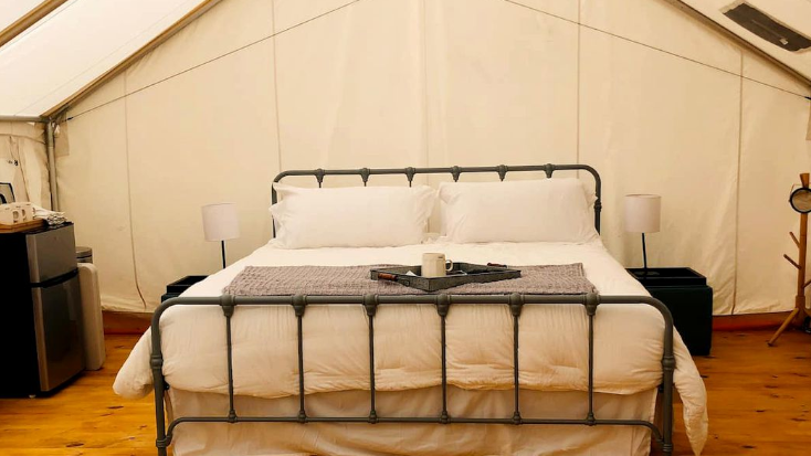 Luxury Queen Bed inside glamping tent in Texas